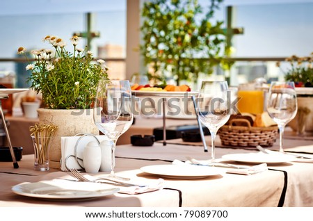 Served table at summer terrace cafe - stock photo
