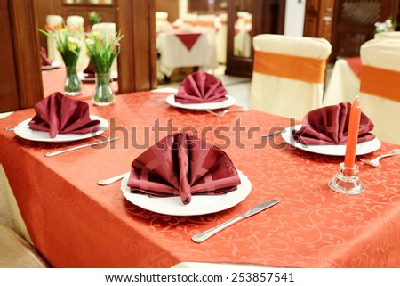 Served table in a restaurant - stock photo