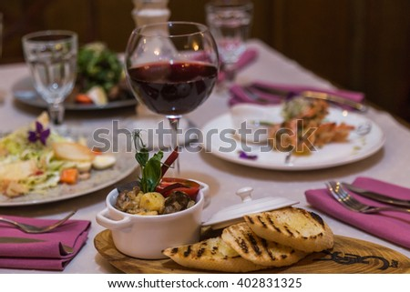 served table in a restaurant. Salad with meat and potatoes. Romantic dinner - stock photo