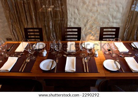 Served table in restaurant interior - stock photo