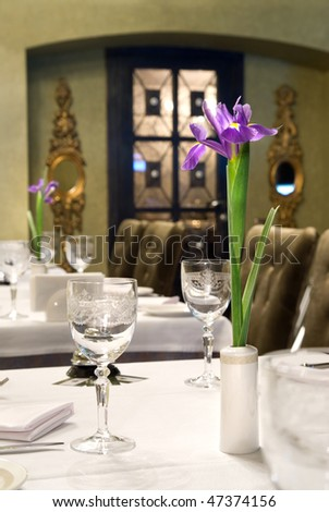 served table in restaurant with flower