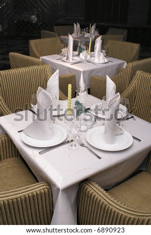 Served tables in restaurant interior with warm background