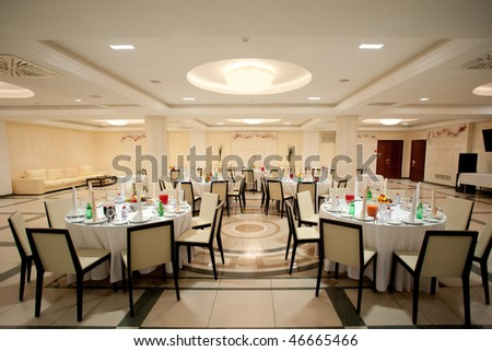 Served tables in the interior of restaurant - stock photo