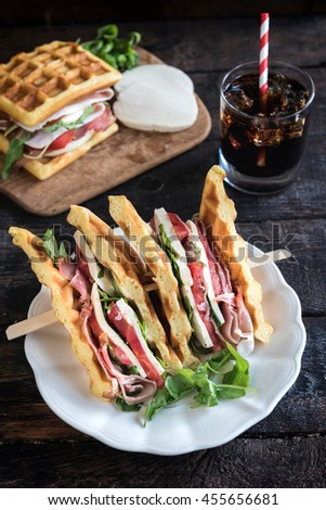 Served waffle sandwiches on the wooden background,selective focus  - stock photo
