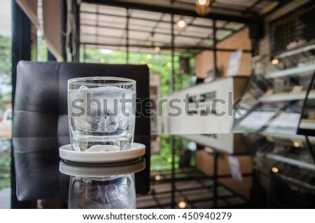 Served water at summer terrace cafe - stock photo