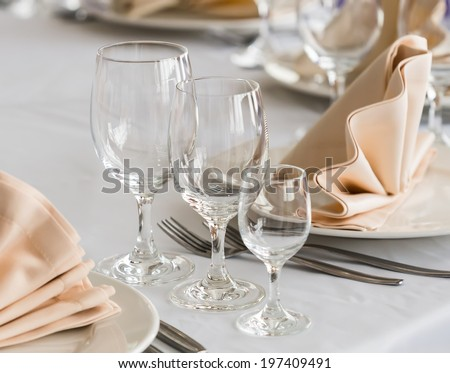 Served with a plate and glasses on the table - stock photo