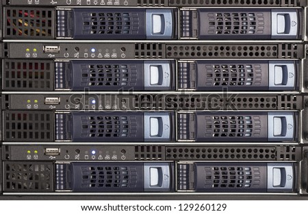 Server Blades and storage in a rack close up