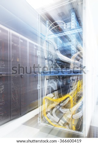server communications equipment inside view with motion - stock photo
