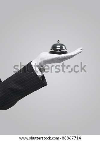 server holding service bell - stock photo