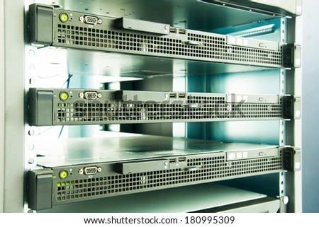 Server machine technology in server room - stock photo