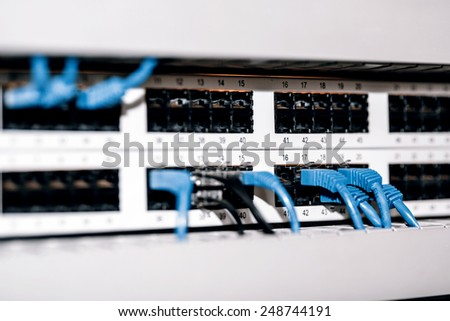 Server panel with blue cables and connectors - network connection - stock photo