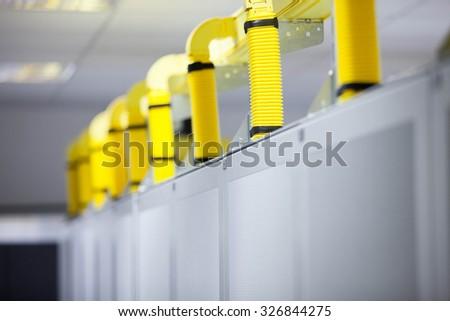 Server Room Network/communications server cluster in a server room - stock photo