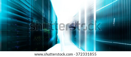 server room panorama of data center with prospect of series supercomputers light and blur