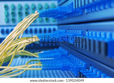 server room routers and fiber optical cables - stock photo