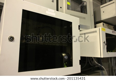 server room with computers for trunk radio system - stock photo