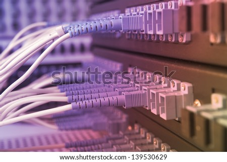 server with fiber optic cables in data center - stock photo