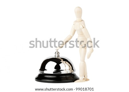 Service Bell and wooden dummy on the white background - stock photo