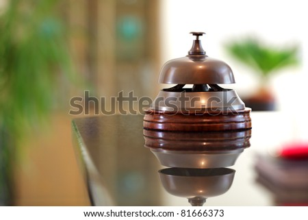Service bell on a hotel reception front desk - stock photo