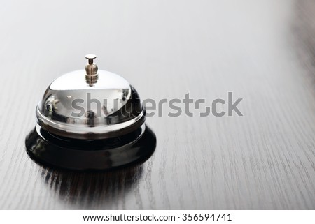 Service bell on dark background with copy space
