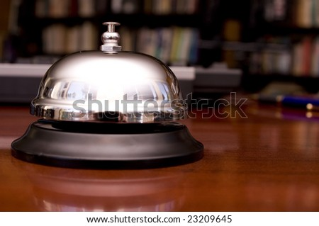 Service Bell on Desk with Pen and Keyboard Background.  Shallow DOF. - stock photo