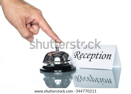 Service bell on the reception desk with white background