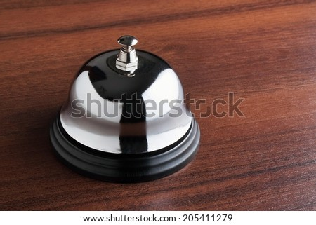 Service bell on wooden table - stock photo