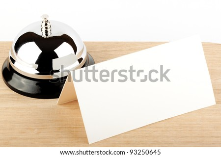 Service Bell with Blank Sign at Hotel Desk - stock photo