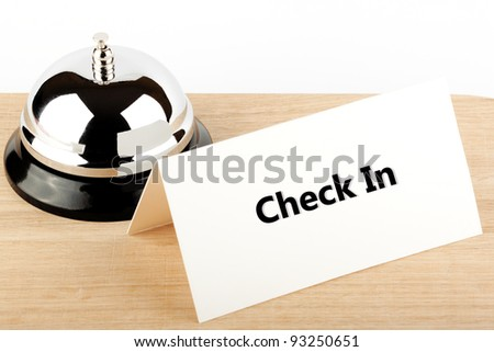Service Bell with Check In Sign at Hotel Desk - stock photo