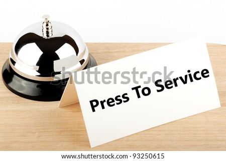 Service Bell with Service Sign at Hotel Desk - stock photo