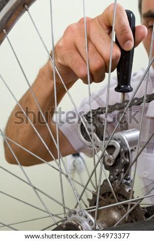 service for bike with adept repairing bike - stock photo