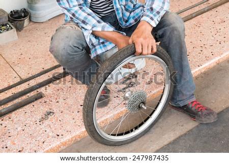 service for bike with repairing bike - stock photo