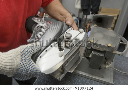 Service for skate with adept repairing skates - stock photo
