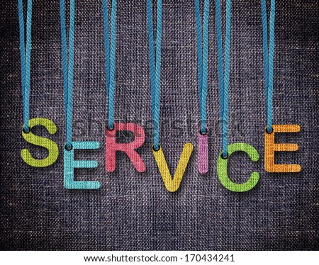 service Letters hanging strings with blue sackcloth background. - stock photo