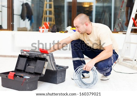 Service man at work using his tools from toolbox. - stock photo