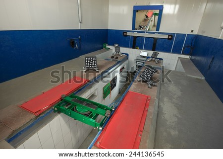 Service station for repair machines, apparatus for balancing wheels - stock photo
