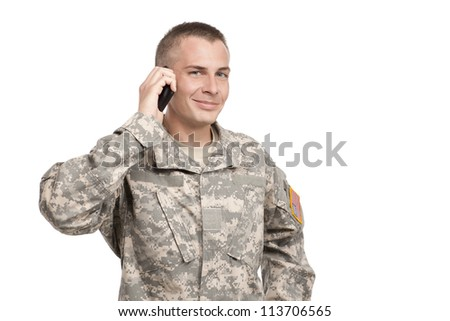 Serviceman on a cellphone - stock photo