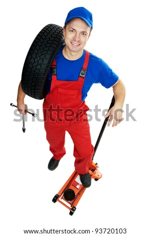 serviceman repairman automobile mechanic with car tire and lifting jack isolated - stock photo