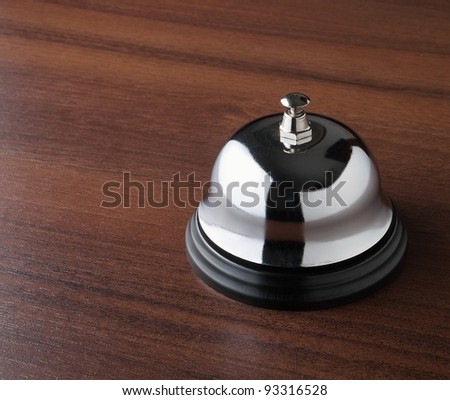 Servicing bell on the wooden table - stock photo