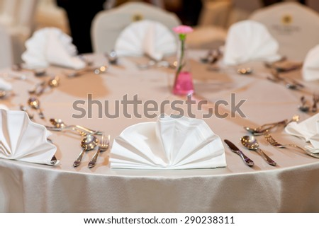 serviette on dining table with extremely shallow dof - stock photo
