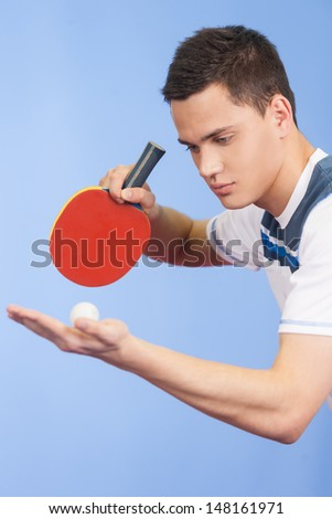 Serving a ball. Confident young men playing table tennis - stock photo