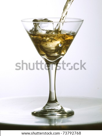 serving a cocktail on a white background