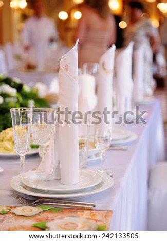 Serving a festive table in restaurant. - stock photo