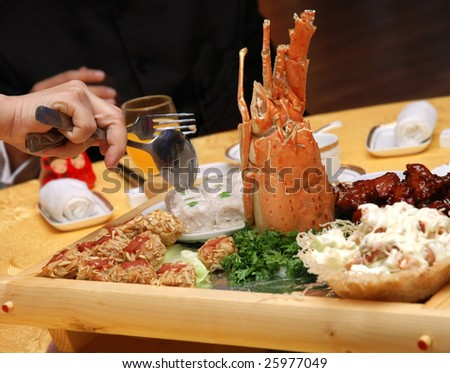serving delicious chinese food - stock photo