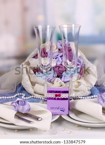 Serving fabulous wedding table in purple color of the restaurant background - stock photo