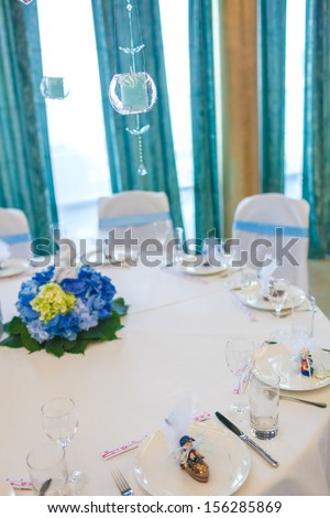 Serving holiday table with white and blue colors - stock photo