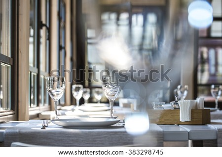 Serving in a summer cafe, shot through the glass Rasfokus - stock photo
