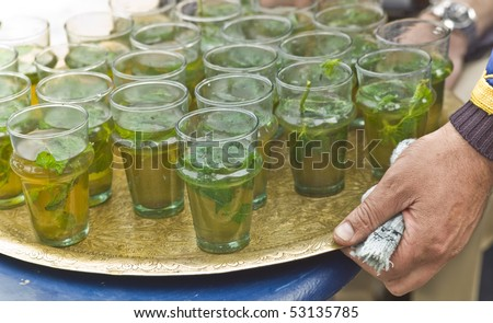 Serving mint tea in a restaurant in Morocco - stock photo
