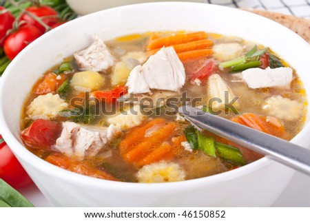 serving of chicken and vegetable soup - stock photo