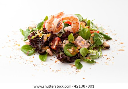 serving of fresh green salad with shrimps on a white background - stock photo