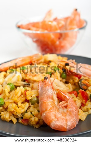 serving of spanish paella - stock photo